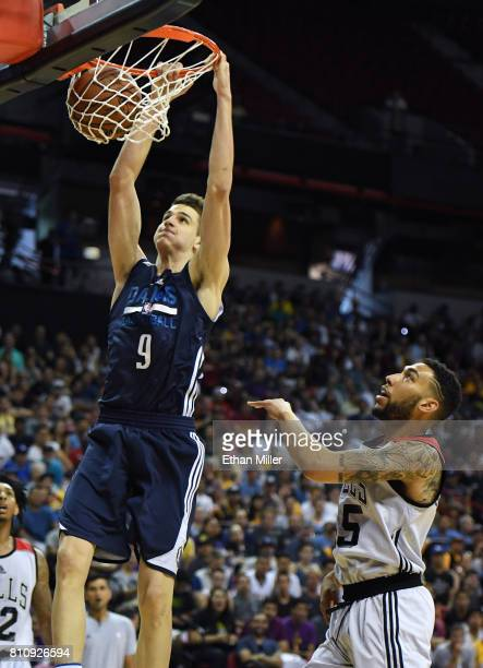 Nicolas Brussino of the Dallas Mavericks dunks ahead of Denzel Valentine of the Chicago Bulls during the 2017 Summer League at the Thomas Mack Center...