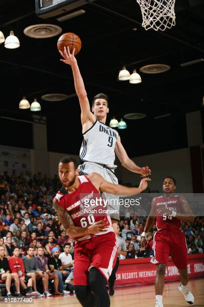 Nicolas Brussino of the Dallas Mavericks goes for a lay up against the Miami Heat during the 2017 Summer League on July 11 2017 at Cox Pavillion in...