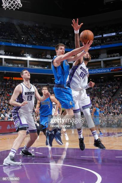 Nicolas Brussino of the Dallas Mavericks goes up for the shot against Willie CauleyStein of the Sacramento Kings on April 4 2017 at Golden 1 Center...