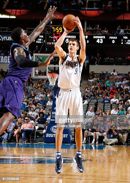 Nicolas Brussino of the Dallas Mavericks shoots a jumper against the Charlotte Hornets on October 3 2016 at the American Airlines Center in Dallas...