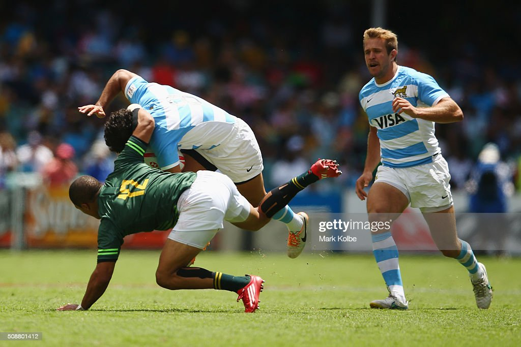 Nicolas Bruzzone of Argentina is tackled by Juan de Jongh of South Africa during the 2016 Sydney Sevens cup quarter final match between South Africa and Argentina at Allianz Stadium on February 7, 2016 in Sydney, Australia.