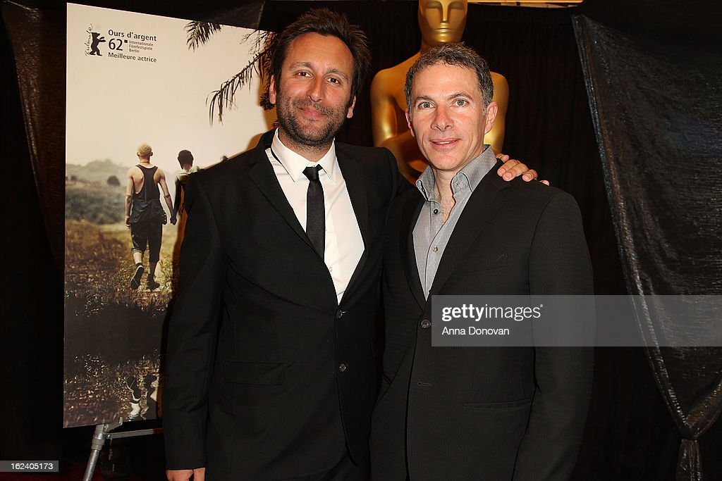Nicolas Bulduc and producer Pierre Even of the film 'War Witch' attends the 85th annual Academy Awards Foreign Language Film Award photoop held at...