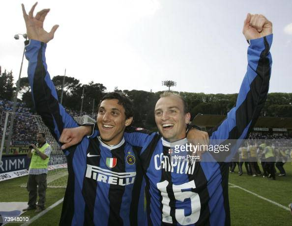 Nicolas Burdisso and Esteban Cambiasso of Inter Milan celebrate after the Italian Serie A football match between AC Siena and FC Inter Milan at the...