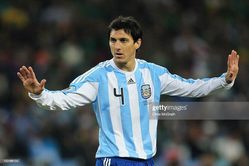 Nicolas Burdisso of Argentina gestures to his team mates during the 2010 FIFA World Cup South Africa Round of Sixteen match between Argentina and...