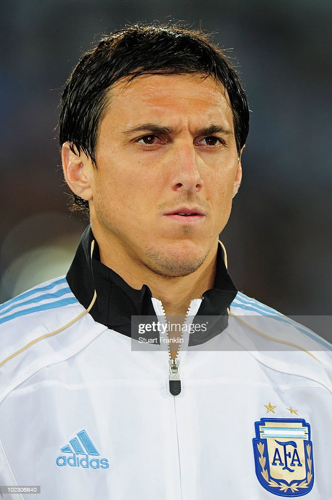 Nicolas Burdisso of Argentina lines up for the national anthems prior to the 2010 FIFA World Cup South Africa Group B match between Greece and...