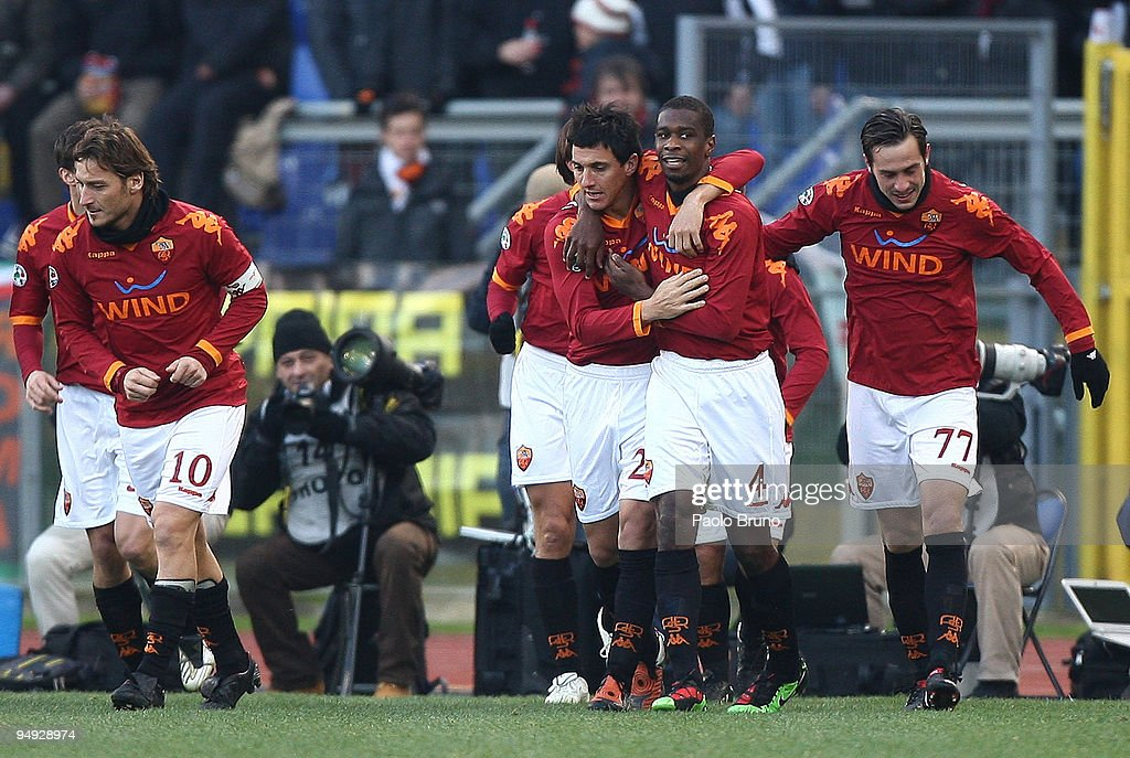 <a gi-track='captionPersonalityLinkClicked' href=/galleries/search?phrase=Nicolas+Burdisso&family=editorial&specificpeople=490963 ng-click='$event.stopPropagation()'>Nicolas Burdisso</a> (3rd R) of AS Roma celebrates his openinig goal with teammates Juan #4, <a gi-track='captionPersonalityLinkClicked' href=/galleries/search?phrase=Marco+Cassetti&family=editorial&specificpeople=709743 ng-click='$event.stopPropagation()'>Marco Cassetti</a> #77 <a gi-track='captionPersonalityLinkClicked' href=/galleries/search?phrase=Francesco+Totti&family=editorial&specificpeople=208985 ng-click='$event.stopPropagation()'>Francesco Totti</a> #10 during the Serie A match between AS Roma and Parma FC at Stadio Olimpico on December 20, 2009 in Rome, Italy.