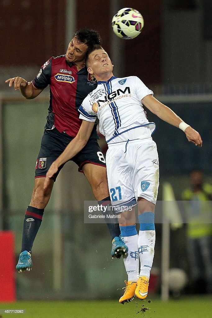 Nicolas Burdisso of Genoa CFC battles for the ball with Piotr Zielinski of Empoli FC during the Serie A match between Genoa CFC and Empoli FC at...