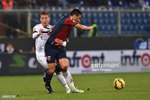Nicolas Burdisso of Genoa CFC clashes with Andrea Belotti of US Citta di Palermo during the Serie A match between Genoa CFC and US Citta di Palermo...