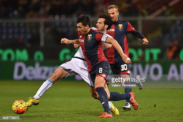 Nicolas Burdisso of Genoa CFC is challenged by Marco Parolo of SS Lazio during the Serie A match between Genoa CFC and SS Lazio at Stadio Luigi...