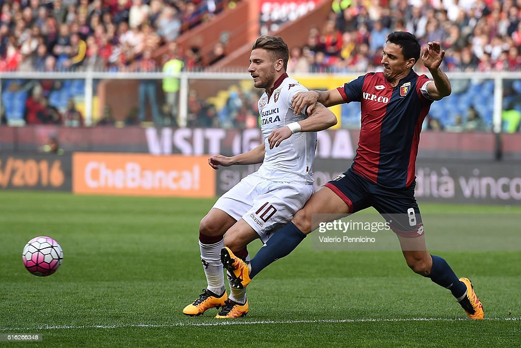 Nicolas Burdisso of Genoa CFC tackles Ciro Immobile of Torino FC during the Serie A match between Genoa CFC and Torino FC at Stadio Luigi Ferraris on...