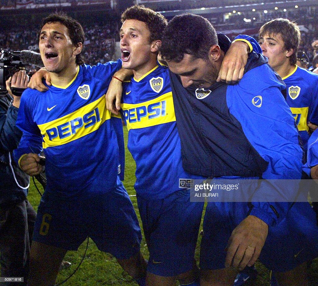 Nicolas Burdisso Pablo Ledesma and Diego Cagna of Boca Juniors celebrate after beating River Plate 54 from the penalties 17 June 2004 at the...