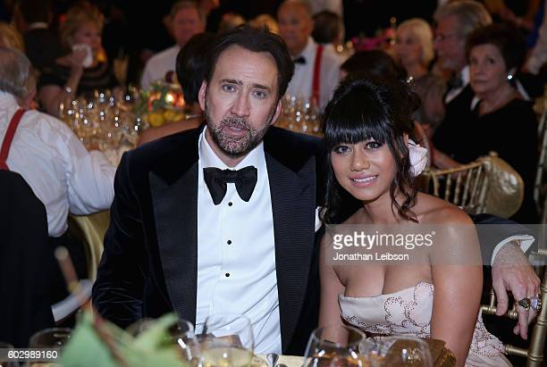 Nicolas Cage and a guest attend the Celebrity Fight Night gala at Palazzo Vecchio as part of Celebrity Fight Night Italy benefiting The Andrea...