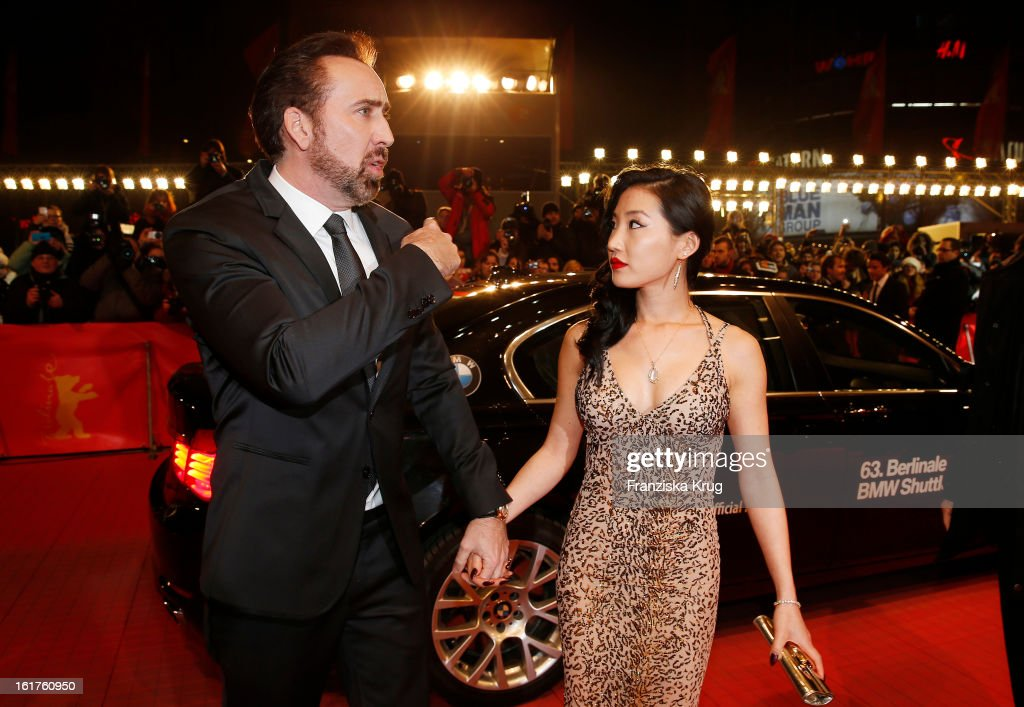 <a gi-track='captionPersonalityLinkClicked' href=/galleries/search?phrase=Nicolas+Cage&family=editorial&specificpeople=196531 ng-click='$event.stopPropagation()'>Nicolas Cage</a> and <a gi-track='captionPersonalityLinkClicked' href=/galleries/search?phrase=Alice+Kim&family=editorial&specificpeople=212731 ng-click='$event.stopPropagation()'>Alice Kim</a> attend 'The Croods' Premiere - BMW at the 63rd Berlinale International Film Festival at Berlinale Palast on February 15, 2013 in Berlin, Germany.