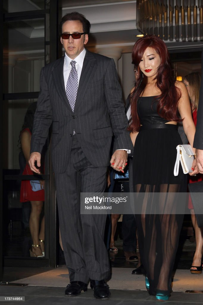 Nicolas Cage and Alice Kim seen leaving their hotel ahead of the Film Premiere of 'The Frozen Ground' on July 17, 2013 in London, England.