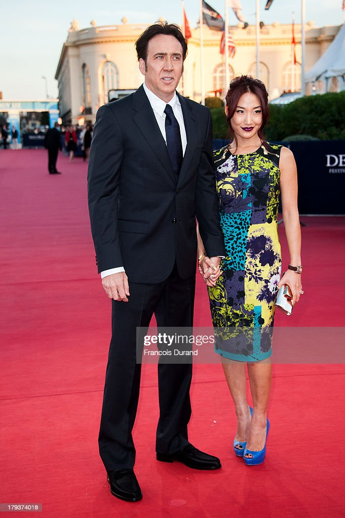 Nicolas Cage and his wife Alice Kim arrive at the premiere of the movie 'Joe' during the 39th Deauville American film festival on September 2, 2013 in Deauville, France.