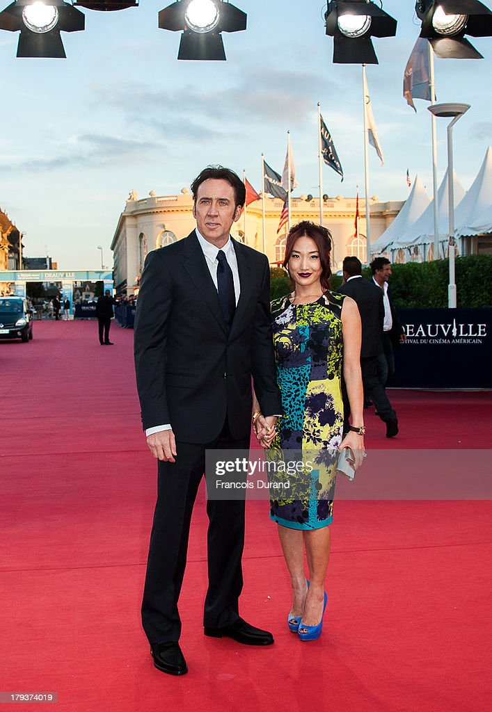 <a gi-track='captionPersonalityLinkClicked' href=/galleries/search?phrase=Nicolas+Cage&family=editorial&specificpeople=196531 ng-click='$event.stopPropagation()'>Nicolas Cage</a> and his wife <a gi-track='captionPersonalityLinkClicked' href=/galleries/search?phrase=Alice+Kim&family=editorial&specificpeople=212731 ng-click='$event.stopPropagation()'>Alice Kim</a> arrive at the premiere of the movie 'Joe' during the 39th Deauville American film festival on September 2, 2013 in Deauville, France.