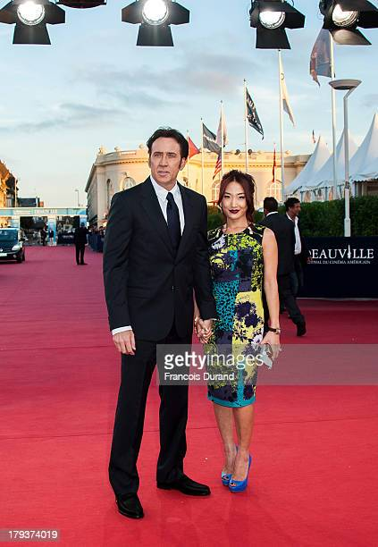 Nicolas Cage and his wife Alice Kim arrive at the premiere of the movie 'Joe' during the 39th Deauville American film festival on September 2 2013 in...