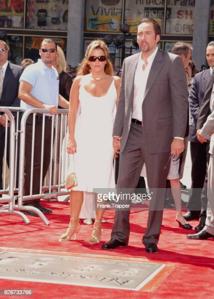 Nicolas Cage and Lisa Marie Presley at the Hand and Footprint ceremony honoring Cage at Grauman's Chinese Theater in Hollywood