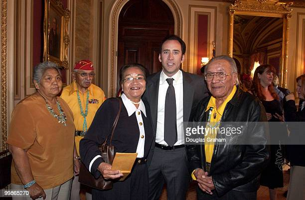 Nicolas Cage greets 'code talker' Allen Dale June and his wife Virginia KnokiJune during the breakfast conference with four of the remaining Navajo...