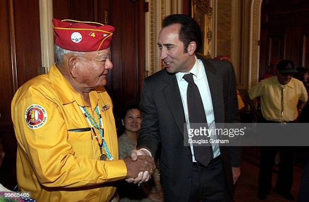 Nicolas Cage greets 'code talker' Keith Little during the breakfast conference with four of the remaining Navajo 'code talkers' from World War II The...