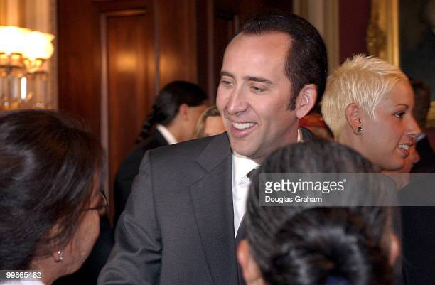 Nicolas Cage greets Virginia KnokiJune wife of 'code talker' Allen Dale June during the breakfast conference with four of the remaining Navajo 'code...