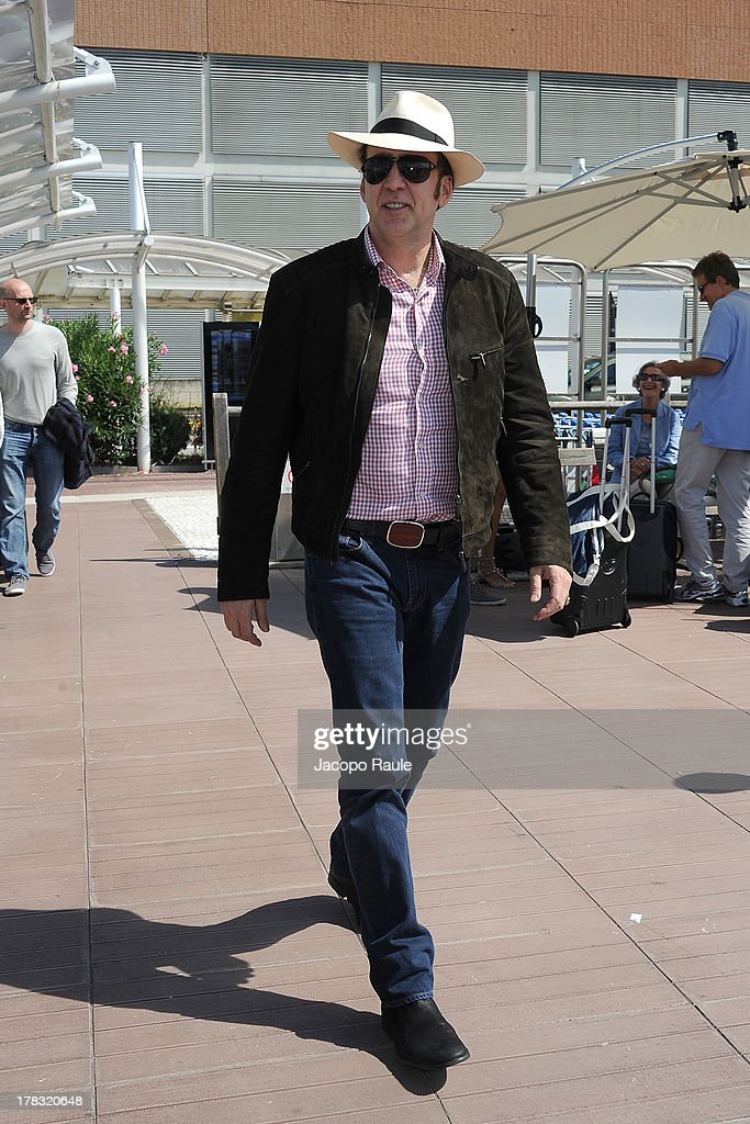 <a gi-track='captionPersonalityLinkClicked' href=/galleries/search?phrase=Nicolas+Cage&family=editorial&specificpeople=196531 ng-click='$event.stopPropagation()'>Nicolas Cage</a> is seen arriving at Venice Airport during The 70th Venice International Film Festival on August 29, 2013 in Venice, Italy.