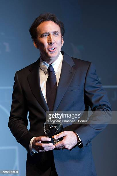 Nicolas Cage receives a tribute before to attend the screening of the movie 'Joe' during the 39th Deauville American Film Festival in Deauville