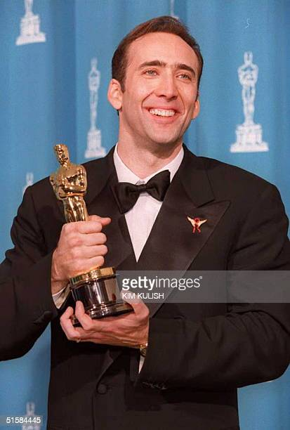 Nicolas Cage the winner of Best Actor for his role as the selfdestructive alcoholic Ben Sanderson in 'Leaving Las Vegas' poses with his Oscar at the...