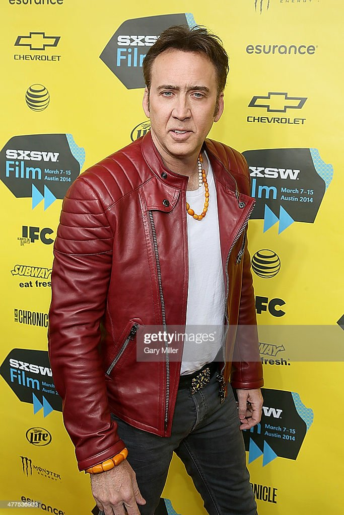 <a gi-track='captionPersonalityLinkClicked' href=/galleries/search?phrase=Nicolas+Cage&family=editorial&specificpeople=196531 ng-click='$event.stopPropagation()'>Nicolas Cage</a> walks the red carpet for the premiere of his new film 'Joe' during the South By Southwest Film Festival on March 9, 2014 in Austin, Texas.