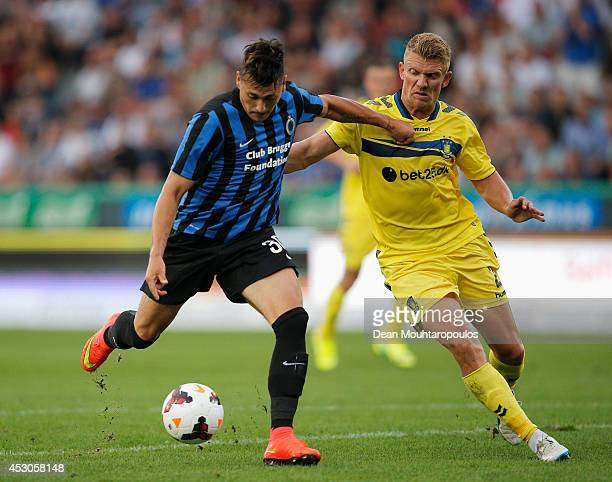 Nicolas Castillo of Brugge shoots on goal as Michael Almeback of Brondby attempts to stop him during the UEFA Europa League 3rd qualifying round...
