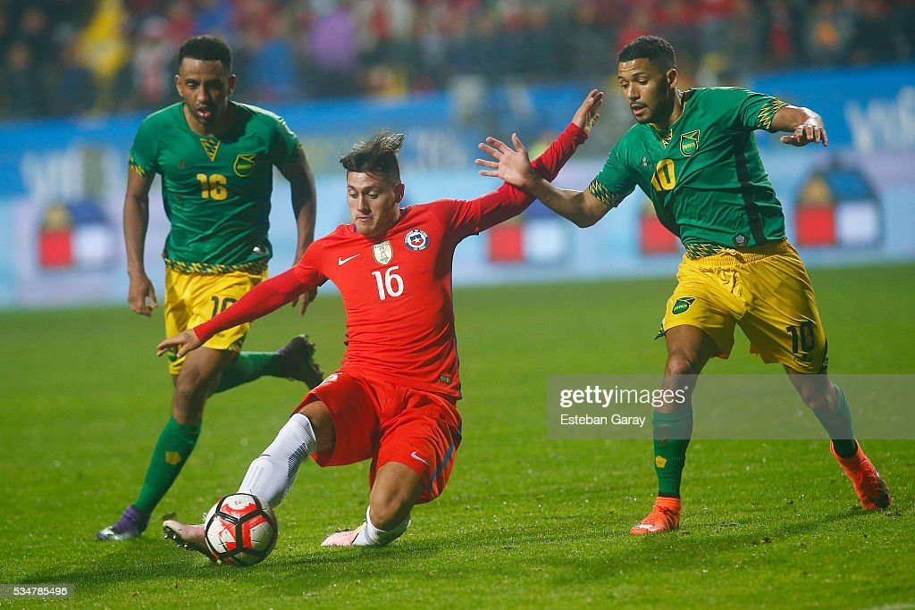 Nicolas Castillo of Chile fights for the ball with Joel Mcanuff of Jamaica during an international friendly match between Chile and Jamaica at Sausalito Stadium on May 27 2015 in Vi–a del Mar, Chile.
