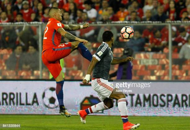 Nicolas Castillo of Chile fights for the ball with Oscar Romero of Paraguay during a match between Chile and Paraguay as part of FIFA 2018 World Cup...