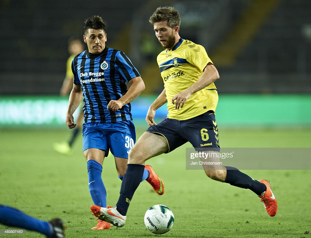 Nicolas Castillo of Club Brugge (L) and Martin Ornskov of Brondby IF in action during UEFA Europa League Third Qualifying Round: Second Leg between Brondby IF and Club Brugge at Brondby Stadium on August 07, 2014 in Brondby, Denmark.