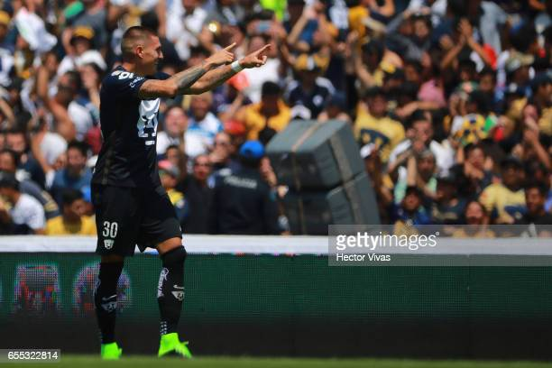 Nicolas Castillo of Pumas celebrates after scoring the second goal of his team during the 11th round match between Pumas UNAM and America as part of...