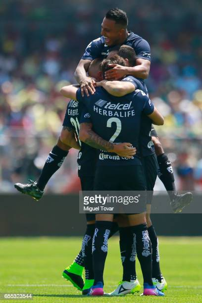 Nicolas Castillo of Pumas celebrates after scoring with teammates during the 11st round match between Pumas UNAM and America as par of the Torneo...