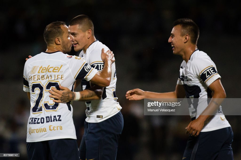 Nicolas Castillo (C) of Pumas celebrates with teammates after scoring his team's first goal during the 6th round match between Pumas UNAM and Morelia as part of the Torneo Apertura 2017 Liga MX at Olimpico Universitario Stadium on August 22, 2017 in Mexico City, Mexico.