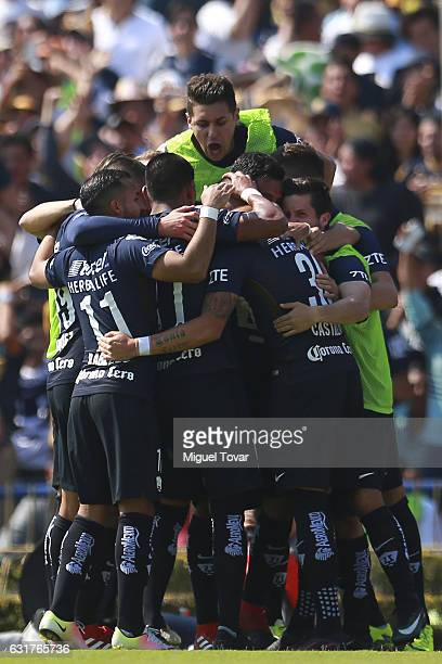 Nicol‡as Castillo of Pumas celebrates with teammates after scoring the first goal of his team during the 2nd round match between Pumas UNAM and Cruz...