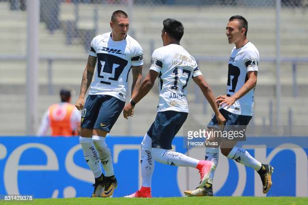 Nicolas Castillo of Pumas celebrates with teammates after scoring the first goal of his team during the fourth round match between Pumas UNAM and...