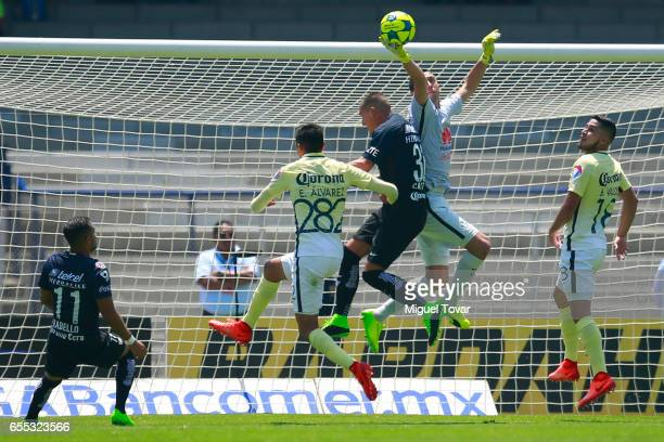 Nicolas Castillo of Pumas fights for the ball with Agustin Marchesin of America during the 11st round match between Pumas UNAM and America as par of...
