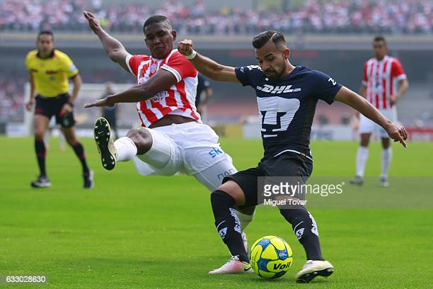 Nicol‡as Castillo of Pumas fights for the ball with Brayan Beckeles of Necaxa during the 4th round match between Pumas UNAM and Necaxa as part of the...