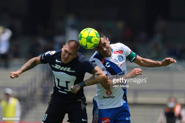 Nicolas Castillo of Pumas fights for the ball with Edgar Dueñas of Puebla during the 17th round match between Pumas UNAM and Puebla as part of the...