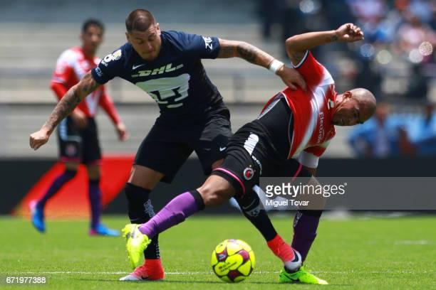 Nicolas Castillo of Pumas fights for the ball with Egidio AreŽvalo of Veracruz during the 15th round match between Pumas UNAM and Veracruz as part of...