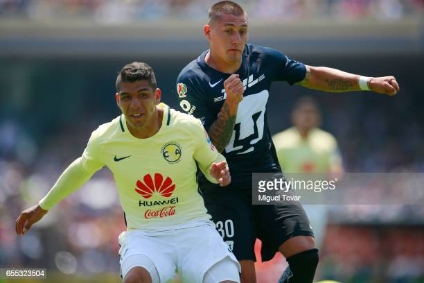 Nicolas Castillo of Pumas fights for the ball with Erik Pimentel of America during the 11st round match between Pumas UNAM and America as par of the...