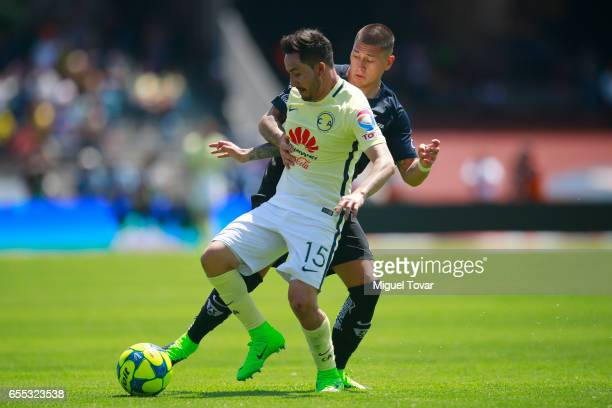 Nicolas Castillo of Pumas fights for the ball with Osmar Mares of America during the 11st round match between Pumas UNAM and America as par of the...