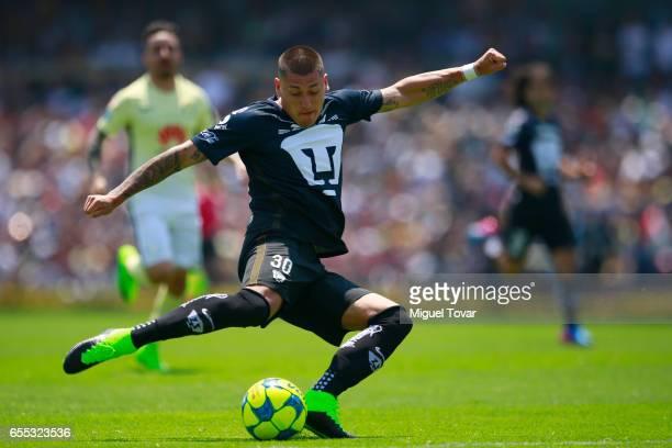 Nicolas Castillo of Pumas kicks the ball to score during the 11st round match between Pumas UNAM and America as par of the Torneo Clausura 2017 Liga...