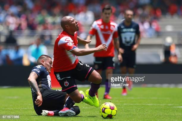 Nicolas Castillo of Pumas makes a foul over Egidio AreŽvalo of Veracruz during the 15th round match between Pumas UNAM and Veracruz as part of the...