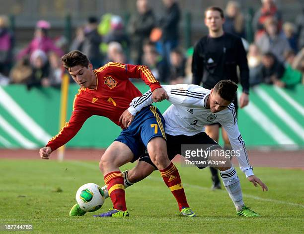Nicolas Clasen of Germany battles for the ball with Sergio Canos Tenes of Spain during the U17 international friendly match between Germany and Spain...