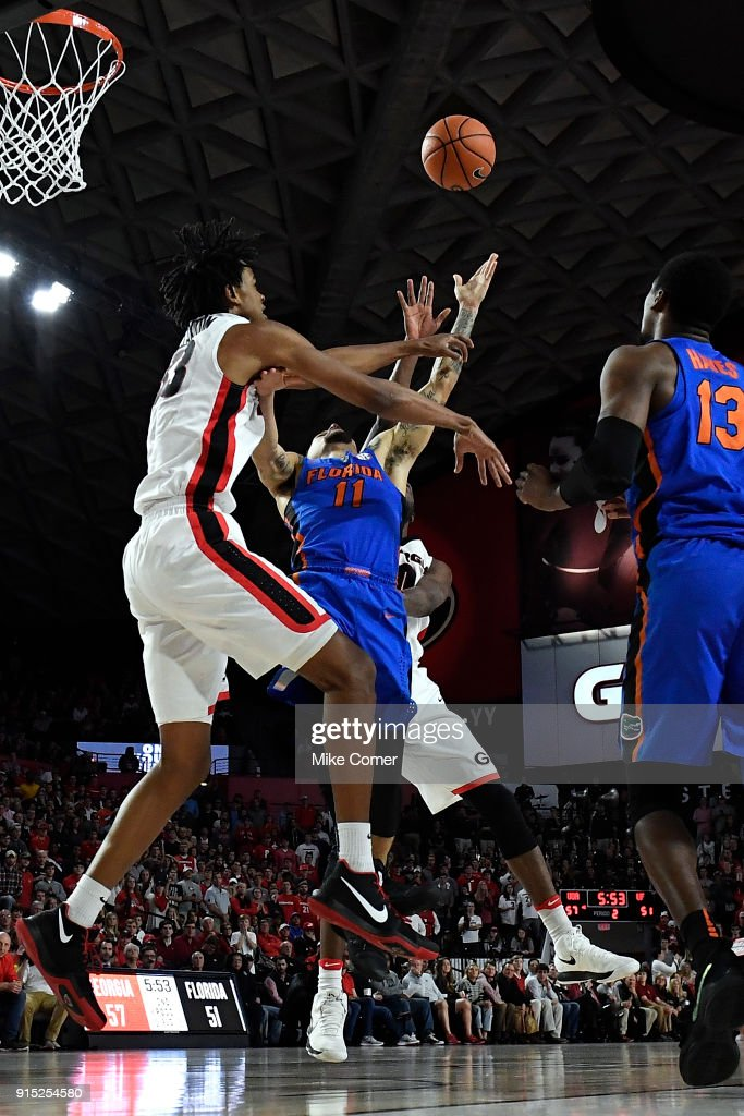 Nicolas Claxton #33 of the Georgia Bulldogs defends as Chris Chiozza #11 of the Florida Gators drives to the basket during the basketball game at Stegeman Coliseum on January 30, 2018 in Athens, Georgia.