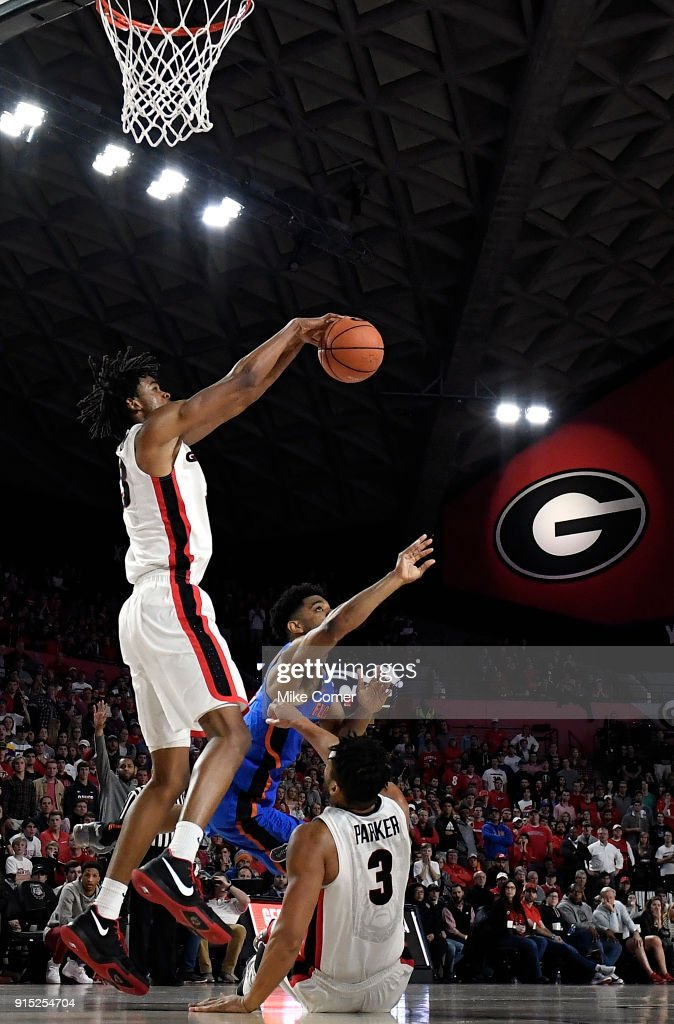 Nicolas Claxton #33 of the Georgia Bulldogs defends the shot of Jalen Hudson #3 of the Florida Gators during the basketball game at Stegeman Coliseum on January 30, 2018 in Athens, Georgia.