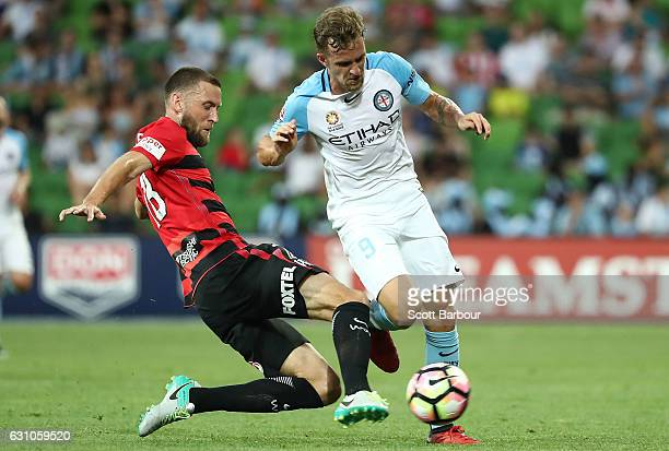 Nicolas Colazo of City FC and Robert Cornthwaite of the Wanderers compete for the ball during the round 14 ALeague match between Melbourne City FC...